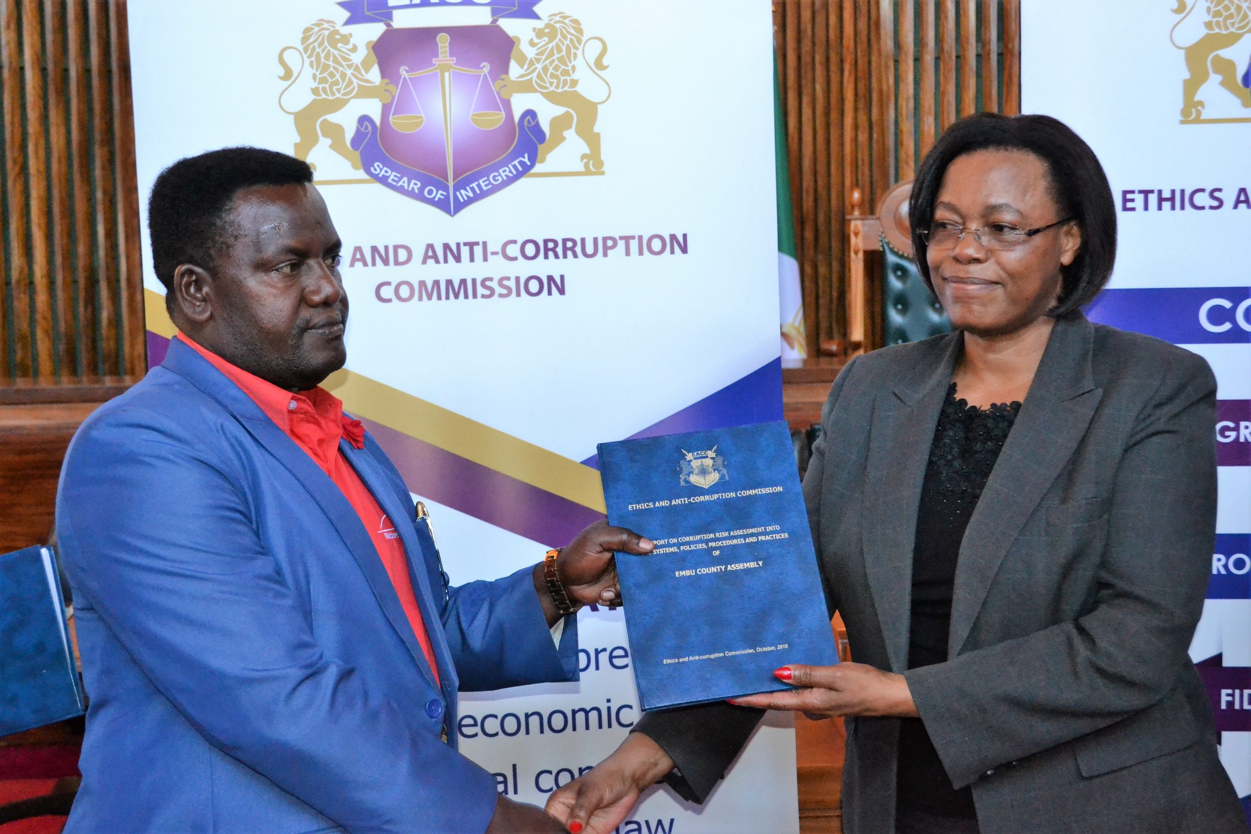 Deputy-Minority-Leader-Muminji-MCA-Newton-Kariuki-receives-the-Embu-County-Assembly-Corruption-Risk-Assessment-Report-from-DeputyEACC-Commissioner-Rose-Mghoi-Macharia